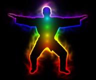 有气氛和chakras的-剪影彩虹主要武士 免版税图库摄影