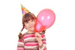 有气球生日聚会的小女孩 免版税库存图片