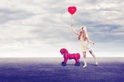 有气球的女孩玩偶 图库摄影