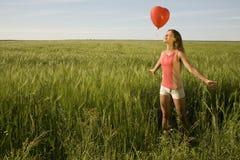 有气球的女孩 库存图片