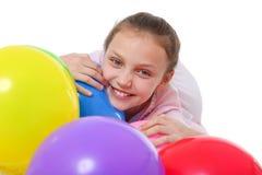 有气球的愉快的女孩 库存图片