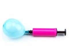 有气球的气泵 免版税库存图片