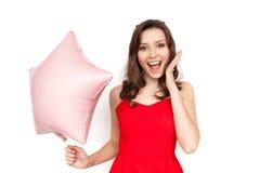 有气球的激动的妇女 免版税库存图片