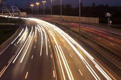 有汽车光足迹的高速公路 免版税图库摄影