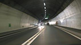 有汽车的路隧道 图库摄影
