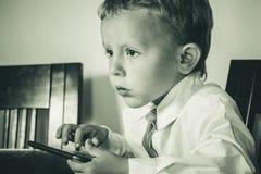 有沉思神色的企业男孩 图库摄影