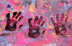 有油漆的三个婴孩手 免版税库存照片