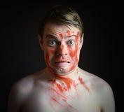 有油漆的人在他的面孔 库存照片