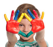 有油漆的小男孩在现有量 免版税库存图片