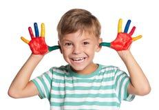 有油漆的小男孩在现有量 库存照片