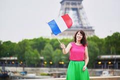 有法国国旗的快乐的少妇 免版税库存图片