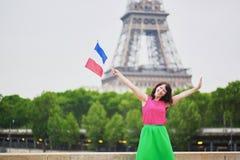 有法国国旗的快乐的少妇 免版税库存照片