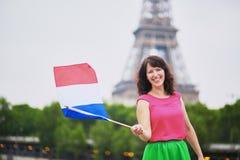 有法国国旗的快乐的少妇 免版税图库摄影