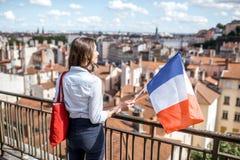 有法国旗子的妇女在利昂 库存图片