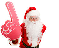 有泡沫手指的体育迷圣诞老人 免版税图库摄影