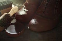 有波兰辅助部件的鞋子 免版税库存照片