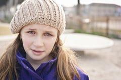有泪花的哀伤的女孩 免版税库存图片