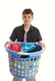 有洗衣篮的少年 库存图片