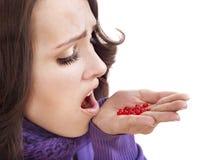 有流感的女孩药片采取 免版税库存图片