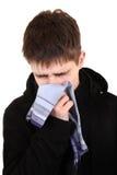 有流感的少年 免版税库存照片