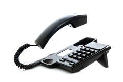 有浮动手机的黑电话 库存图片