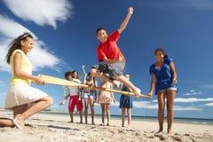 有海滩的乐趣少年 库存照片