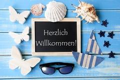 有海装饰的, Willkommen手段欢迎黑板 库存图片