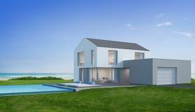 有海视图游泳池的豪华海滨别墅在现代设计,大家庭的别墅 免版税库存照片