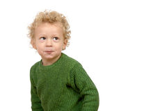 有淘气神色的一个小男孩 库存照片