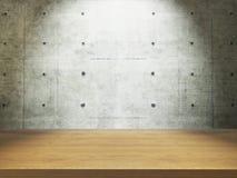有混凝土墙的木书桌 免版税库存图片