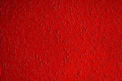 有渐晕的红颜色难看的东西被构造的墙壁特写镜头,可以 库存照片