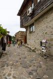 有游人的一条街道在老镇 图库摄影