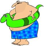 有游泳玩具的肥胖人 免版税图库摄影