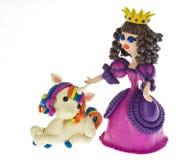 有滑稽的独角兽的彩色塑泥公主 库存图片