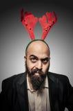 有滑稽的表达式的怀疑圣诞节有胡子的人 库存图片