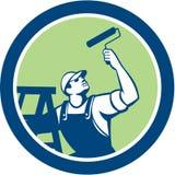 有漆滚筒的减速火箭房屋油漆工和的梯子 免版税库存照片