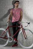 有激情和他的自行车的人 库存图片