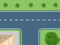有灌木和房子的交叉路 免版税库存照片