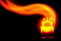 有火焰的瓶 免版税库存图片