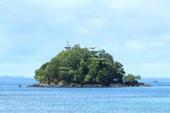 有灯塔的海岛 库存图片