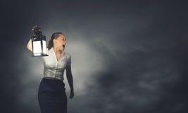 有灯笼的女实业家 免版税库存照片