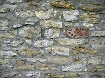 有灰浆的岩石墙壁 库存照片
