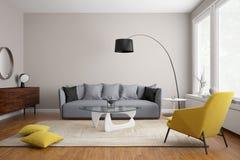 有灰色沙发的现代斯堪的纳维亚客厅 图库摄影