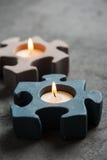 有灼烧的蜡烛的烛台在石背景 免版税图库摄影