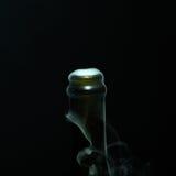 有烟的香宾瓶 库存图片
