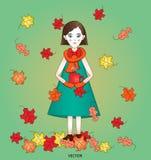有热的茶的时髦的逗人喜爱的秋天女孩在绿色背景的与明亮落离开 免版税库存图片