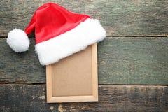 有照片框架的圣诞老人帽子 库存照片