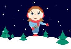 有照相机的冬天女孩 免版税图库摄影