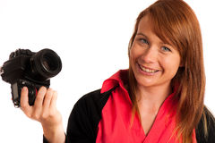 有照相机的少妇摄影师在她的手上 免版税图库摄影