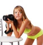有照相机的性感的女孩 免版税库存图片
